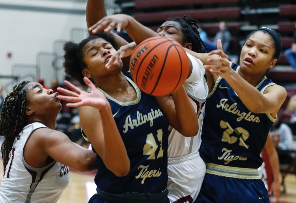 <strong>Arlington&rsquo;s Keanna Coburn (second (left) and Taylor Dupree (right) battle Collierville&rsquo;s Mannie Amaefula (left) and Jordan Harris (middle) for a rebound on Monday, March 8, 2021.</strong> (Mark Weber/The Daily Memphian)