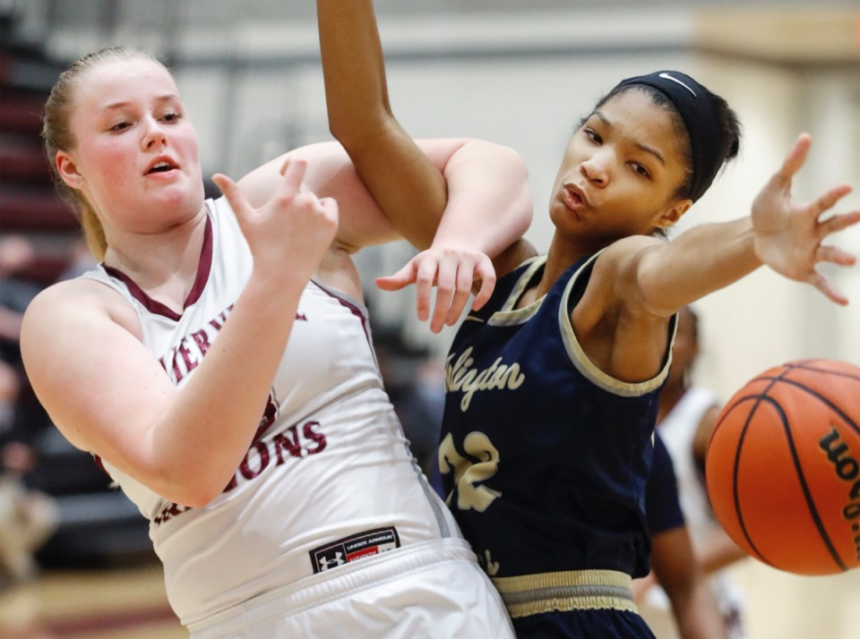 <strong>Collierville forward Madison Lovelace (left) battles Arlington defender Taylor Dupree (right) for a loose ball on Monday, March 8, 2021.</strong> (Mark Weber/The Daily Memphian)