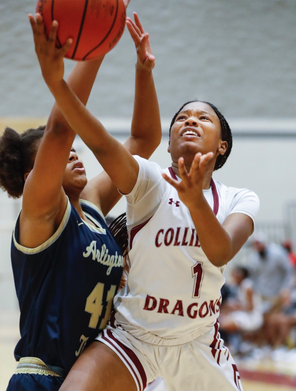 <strong>Collierville guard Mallory Taylor (right) drives the lane against Arlington defender Keanna Coburn (left) on Monday, March 8, 2021.</strong> (Mark Weber/The Daily Memphian)