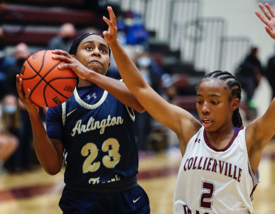 <strong>Arlington guard Carmen Taylor (left) drives the lane against Collierville&rsquo;s Nakiyah Westbrook (right) on Monday, March 8, 2021.</strong> (Mark Weber/The Daily Memphian)