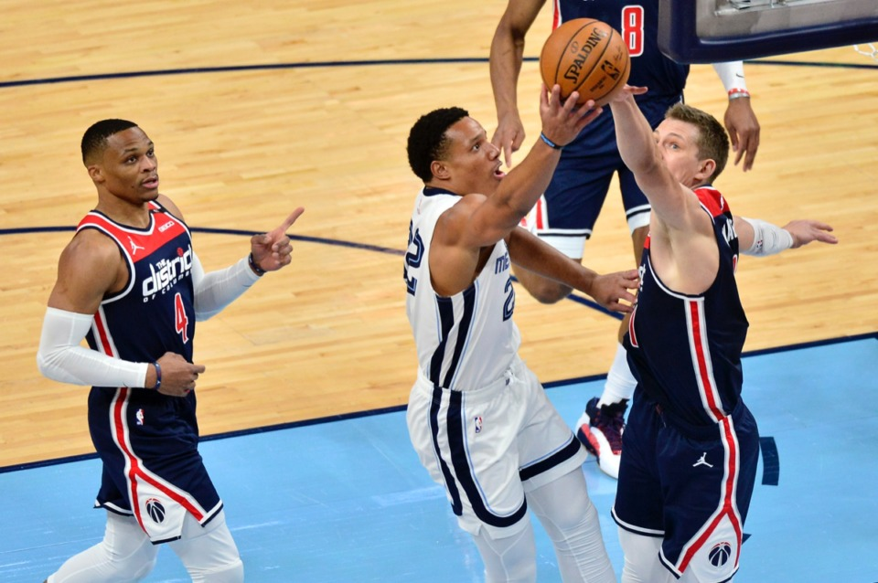 <strong>Grizzlies guard Desmond Bane (22) shoots against Washington Wizards guard Garrison Mathews (24) while guard Russell Westbrook (4) watches on March 10 at FedExForum.</strong> (Brandon Dill/AP)