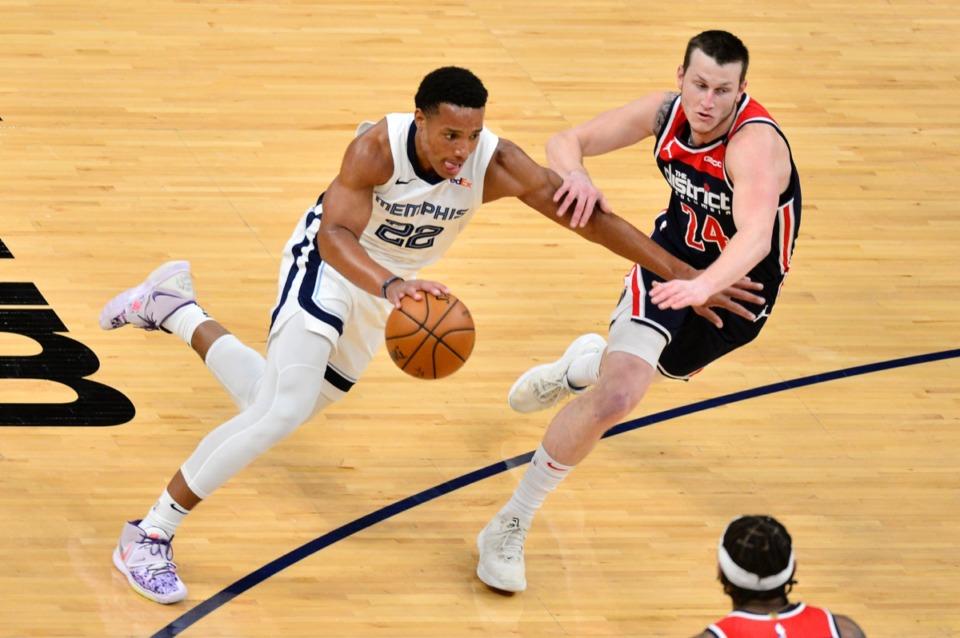 <strong>Grizzlies guard Desmond Bane (22) drives against Washington Wizards guard Garrison Mathews (24) on March 10 at FedExForum.</strong> (Brandon Dill/AP)