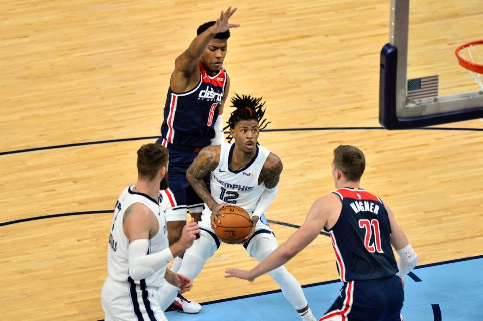 <strong>Grizzlies guard Ja Morant (12) looks to shoot between Washington Wizards center Moritz Wagner (21) and forward Rui Hachimura (8)&nbsp;on March 10 at FedExForum.</strong> (Brandon Dill/AP)