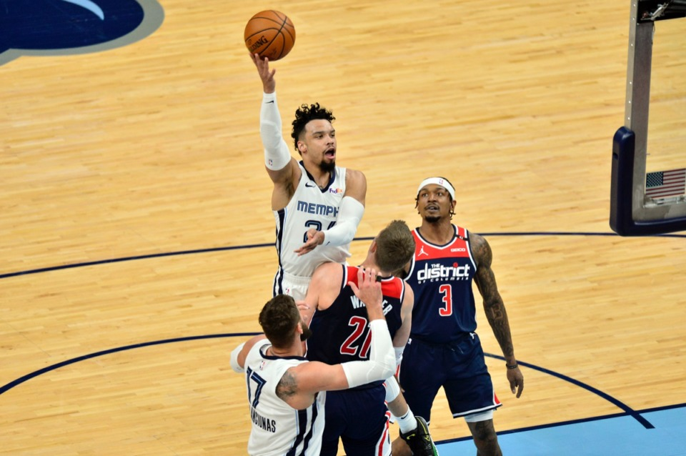 <strong>Grizzlies guard Dillon Brooks (24) shoots against Washington Wizards center Moritz Wagner (21) and guard Bradley Beal (3)&nbsp;on March 10 at FedExForum.</strong> (Brandon Dill/AP)