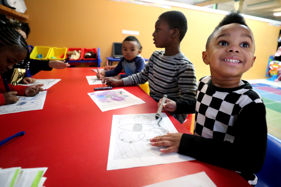 <strong>Eddison Wellington, 3, works with classmates at Peachtree Academy as they draw colorful butterflies during a class project. The 11-year-old day care and after school progam recently was acquired by the city in order to complete the $22 million widening of Old Brownsville Road. Cynthia Hopson, owner of Peachtree Academy, says she has been forced out without fair compensation and is suing the city.</strong> (Houston Cofield/Daily Memphian)
