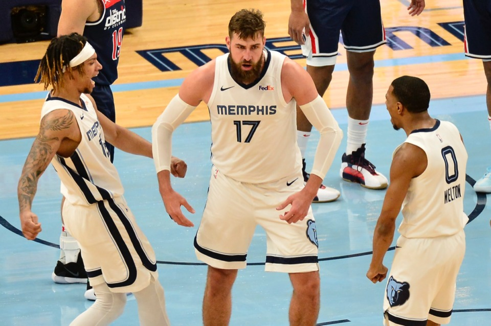 <strong>Grizzlies center Jonas Valanciunas (17) reacts with teammates Brandon Clarke (15) and De'Anthony Melton (0) after scoring on March 10, 2021, at FedExForum.</strong> (Brandon Dill/AP)