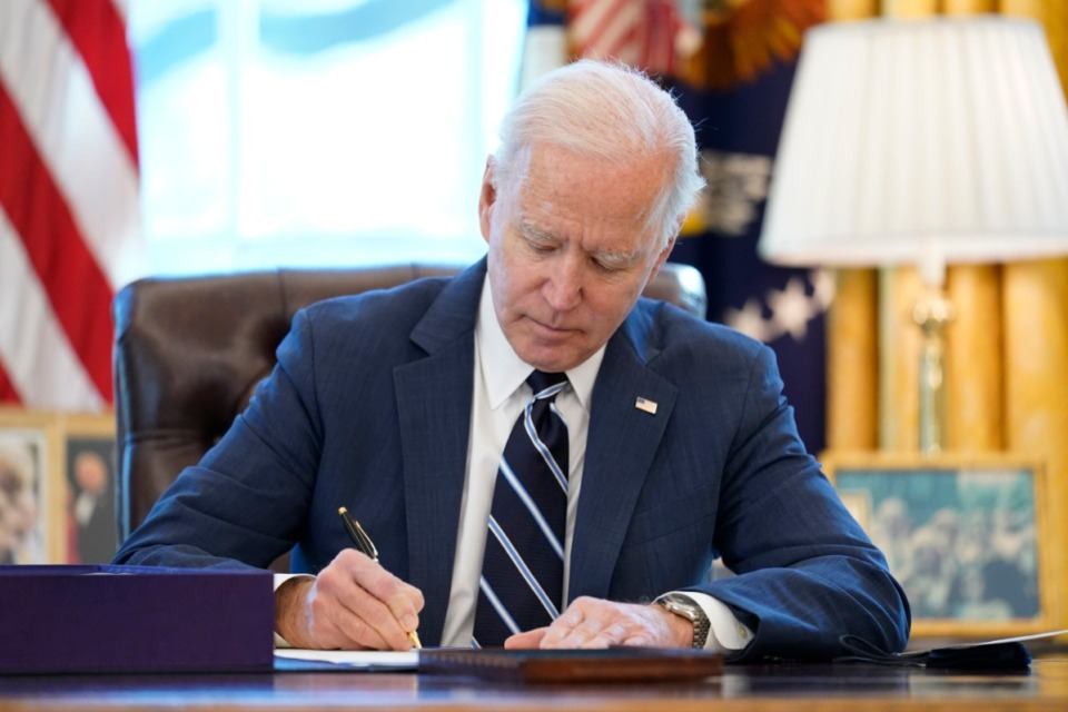 <strong>President Joe Biden signs the American Rescue Plan, a coronavirus relief package, in the Oval Office of the White House, Thursday, March 11, 2021, in Washington.</strong> (Andrew Harnik/AP)