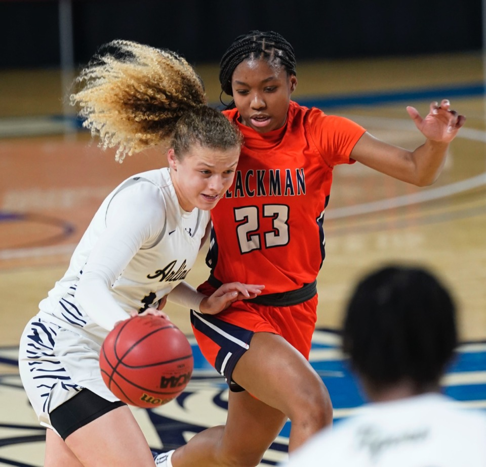 <strong>Arlington&rsquo;s Alindsey Long (12) tries to drive by Blackman&rsquo;s Iyana Moore (23)</strong>&nbsp;<strong>on March 11 in Murfreesboro, Tennessee.&nbsp;</strong>(Larry McCormack/Special to The Daily Memphian.)