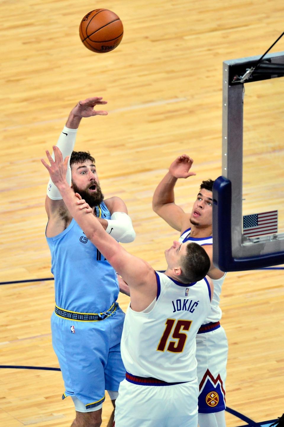 <strong>Memphis Grizzlies center Jonas Valanciunas (17) shoots against Denver Nuggets center Nikola Jokic (15) and forward Michael Porter Jr.&nbsp;on March 12 at FedExForum.</strong> (Brandon Dill/AP)