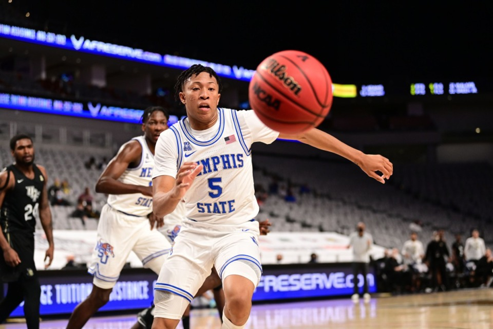 <strong>Boogie Ellis (5) chases a loose ball as the University of Memphis Tigers battle the University of Central Florida on March 12, 2021.</strong> (Courtesy American Athletic Conference/Ben Solomon)