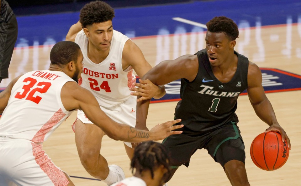<strong>Houston&rsquo;s Quentin Grimes (24) and forward Reggie Chaney (32) guard Tulane guard Sion James (1) in the quarterfinal game on March 12 in Fort Worth, Texas. Houston won, meaning Memphis will see them again.</strong>&nbsp;(Ron Jenkins/AP)