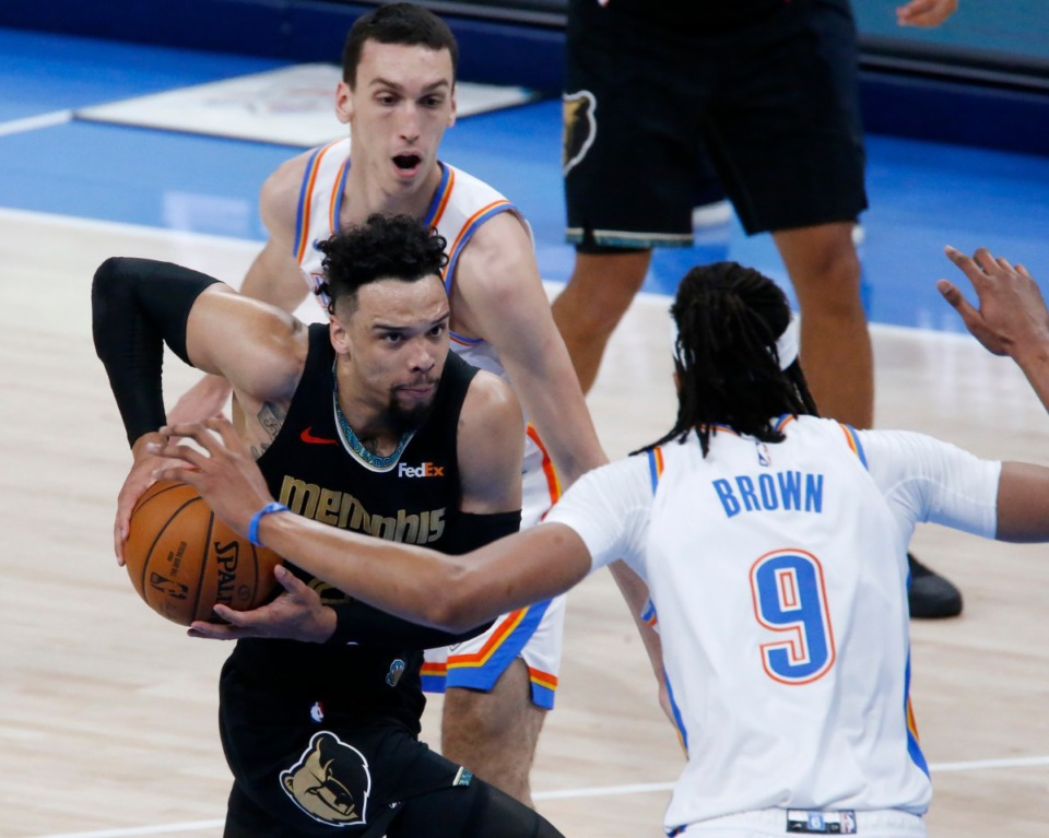<strong>Memphis Grizzlies guard Dillon Brooks (center) goes against Oklahoma City Thunder center Moses Brown (right), and forward Aleksej Pokusevski during&nbsp; an NBA basketball game, Sunday, March 14, 2021, in Oklahoma City.</strong> (Garett Fisbeck/AP)