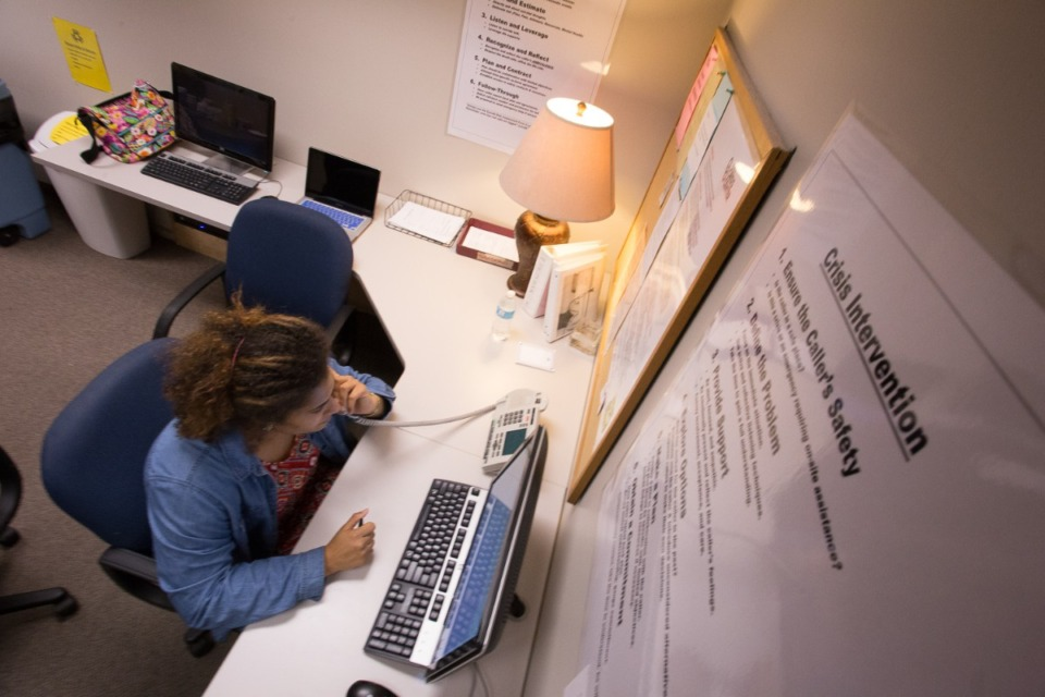 <strong>A volunteer (in a file photo) takes a call at Memphis Crisis Center, where calls related to unemployment, homelessness and food insecurity increased in 2020, said executive director Mike LaBonte.&nbsp;&ldquo;Overall, for many people this past year has been emotionally exhausting,&rdquo;</strong>&nbsp;<strong>he said.</strong> (Daily Memphian)
