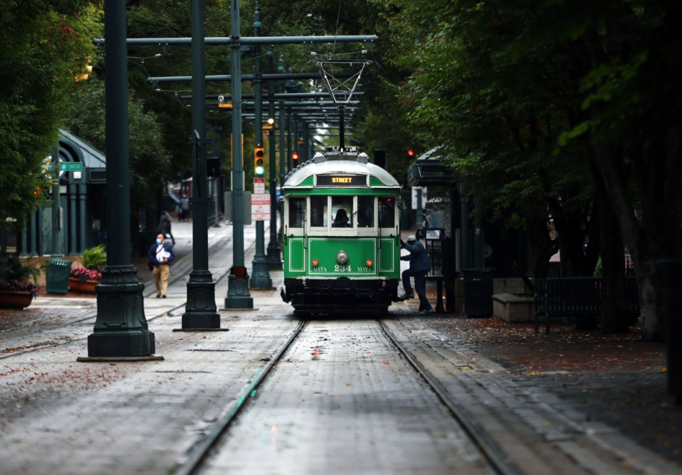 <strong>A passenger hops onto the Main Street Trolley in Downtown Memphis Oct. 29, 2020.</strong> (Patrick Lantrp/Daily Memphian)