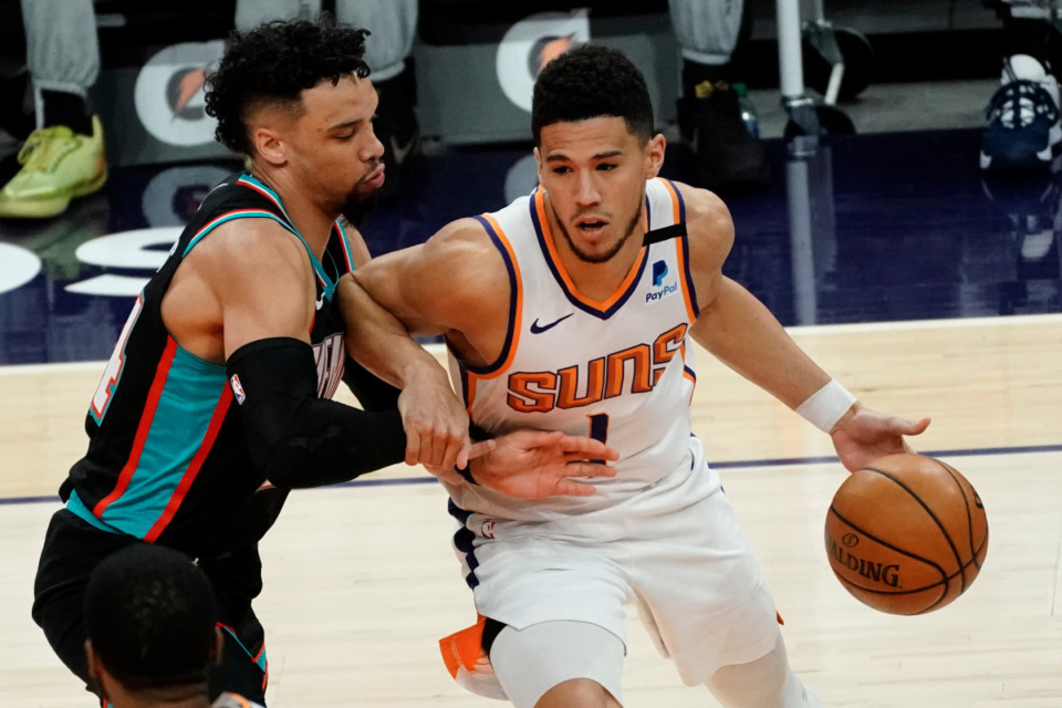 <strong>Phoenix Suns guard Devin Booker (1) is pressured by Memphis Grizzlies guard Dillon Brooks during the first half of an NBA basketball game Monday, March 15, 2021, in Phoenix.</strong> (AP Photo/Rick Scuteri)