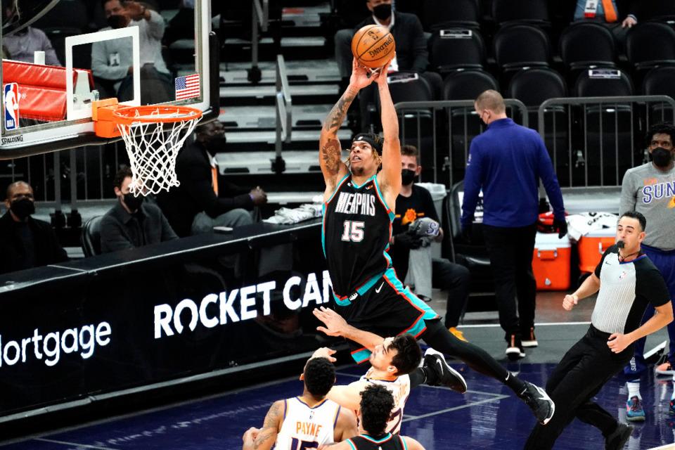 <strong>Memphis Grizzlies forward Brandon Clarke (15) shoots over Phoenix Suns guard Cameron Payne (15) and forward Dario Saric during the first half of an NBA basketball game Monday, March 15, 2021, in Phoenix.</strong> (AP Photo/Rick Scuteri)