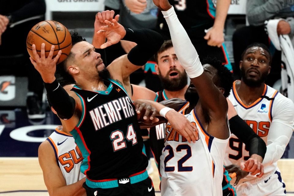 <strong>Memphis Grizzlies guard Dillon Brooks (24) shoots against Phoenix Suns center Deandre Ayton (22) during the second half of an NBA basketball game, Monday, March 15, 2021, in Phoenix. Phoenix won 122-99.</strong> (AP Photo/Rick Scuteri)