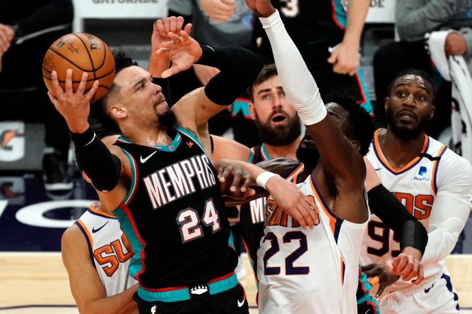 <strong>Memphis Grizzlies guard Dillon Brooks (24) shoots against Phoenix Suns center Deandre Ayton (22) during the second half of an NBA basketball game, Monday, March 15, 2021, in Phoenix. Phoenix won 122-99.</strong> (AP Photo/Rick Scuteri)