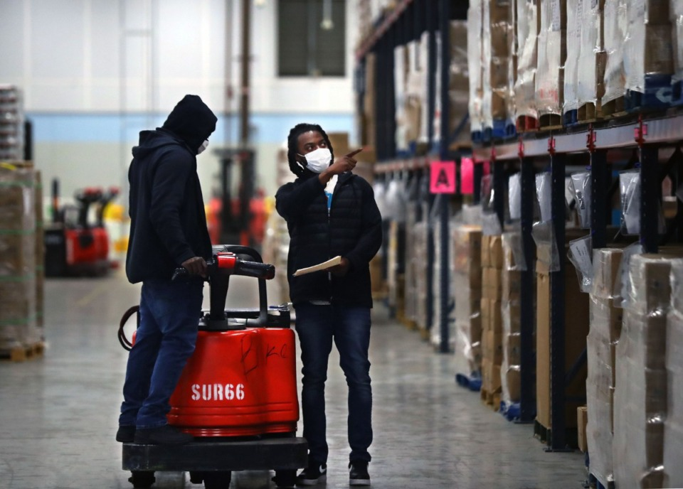<strong>Mid-South Food Bank employees take inventory at the nonprofit's south Memphis warehouse Dec. 15, 2020.&nbsp;</strong>(Patrick Lantrip/Daily Memphian file)
