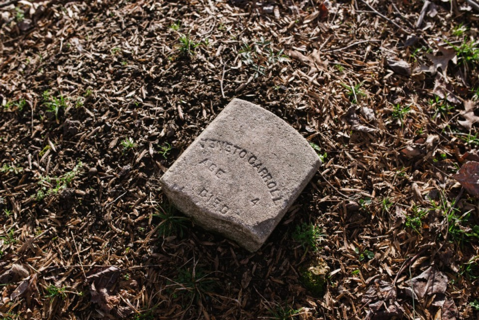 <strong>A remnant of a headstone from the grave of a young child in Zion Christian Cemetery Tuesday, March 16, 2021.</strong> (Lucy Garrett/Special to the Daily Memphian)