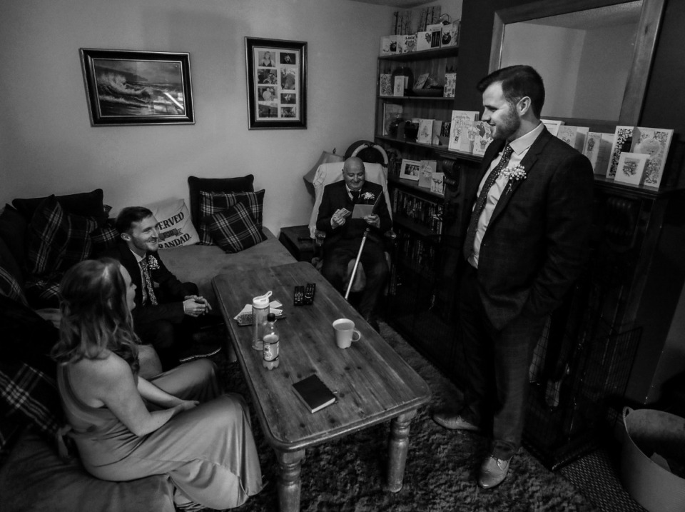 <strong>Martin Nilan opens a wedding card while surrounded by his children (from left) R&oacute;is&iacute;n Nilan, Ciar&aacute;n Nilan and Conor Nilan at his home in County Clare, Ireland March 21, 2020.</strong> (Patrick Lantrip/Daily Memphian)