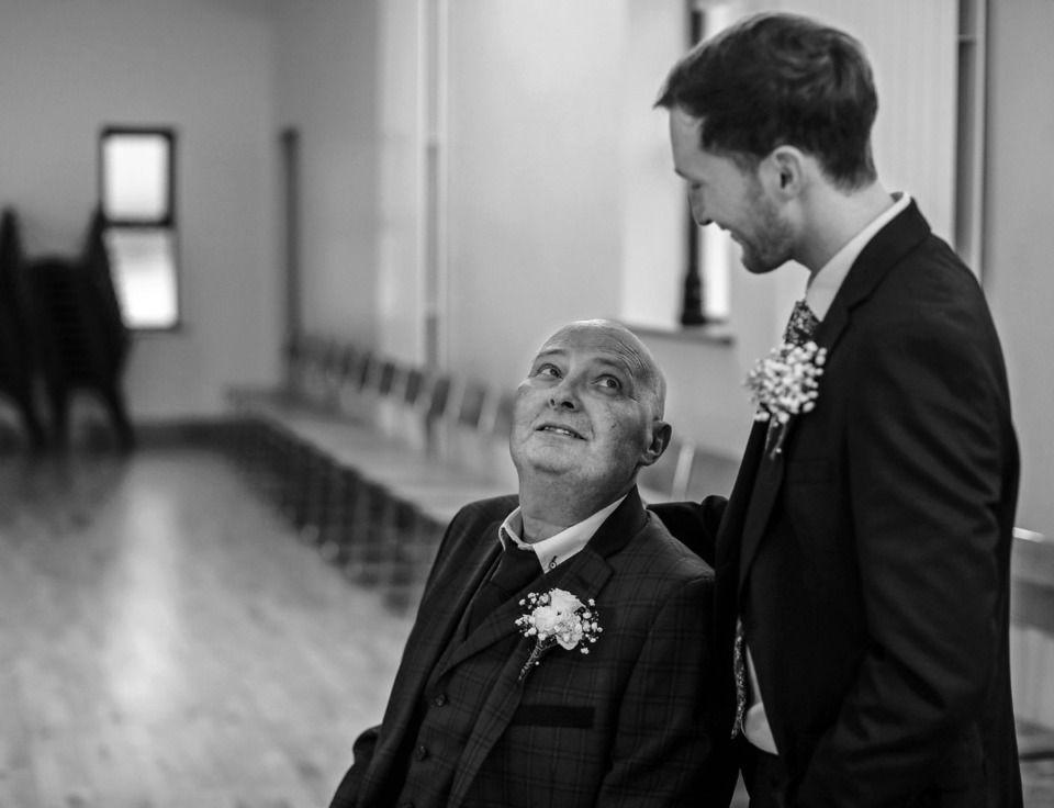 <strong>Martin Nilan shares a moment with his son Ciar&aacute;n Nilan after his wedding March 21, 2020.</strong> (Patrick Lantrip/Daily Memphian)
