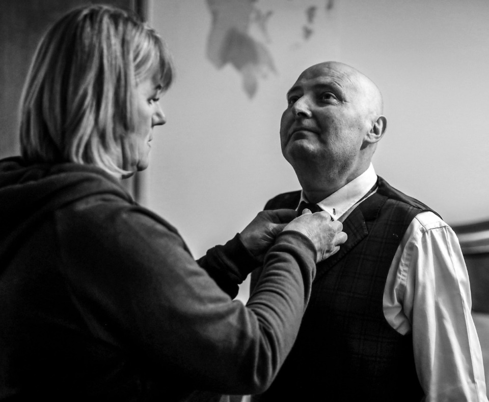 <strong>Christina Scheunemann Nilan helps her husband Martin Nilan get his tie on before their wedding on March 21, 2020. Martin was diagnosed with cancer in January and passed away in June 2020.</strong> (Patrick Lantrip/Daily Memphian)