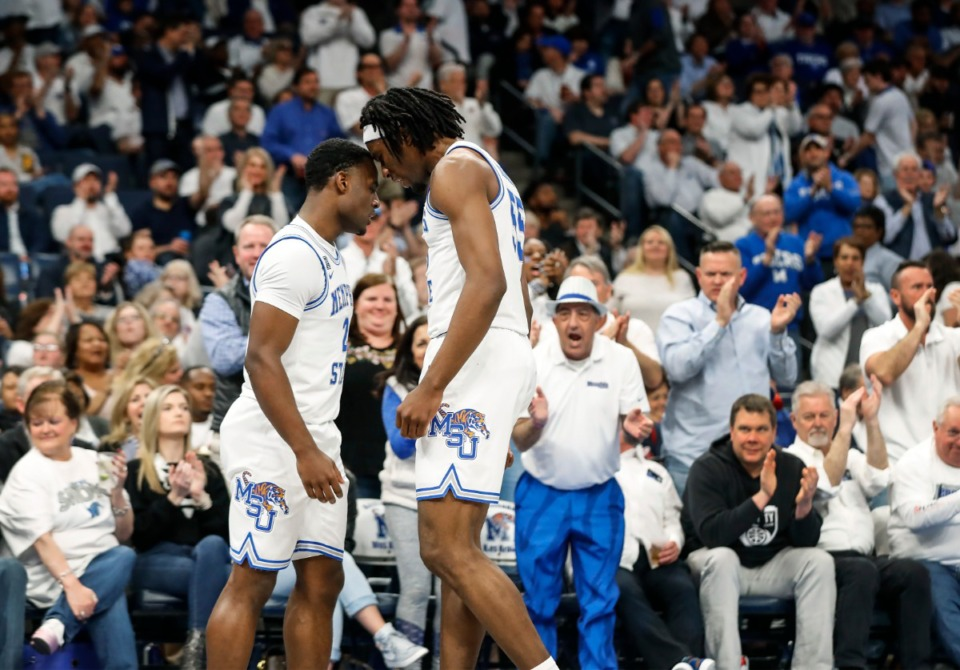 <strong>Memphis guard Alex Lomax (left) celebrated with teammate Precious Achiuwa (right) after scoring during a March 2020 game against Wichita State at the FedExForum.</strong> (Mark Weber/Daily Memphian file)