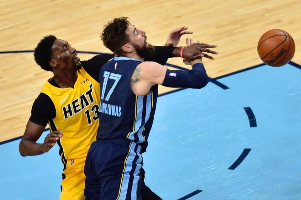 <strong>Miami Heat center Bam Adebayo (13) fouls Memphis Grizzlies center Jonas Valanciunas (17) on March 17, 2021, at FedExForum.</strong> (Brandon Dill/AP)