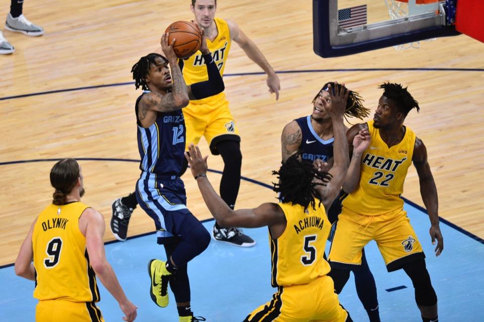 <strong>Memphis Grizzlies guard Ja Morant (12) shoots in front of Miami Heat forward Precious Achiuwa (5)&nbsp;on March 17, 2021, at FedExForum.</strong> (Brandon Dill/AP)