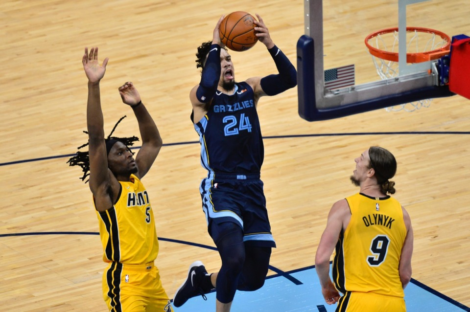 <strong>Memphis Grizzlies guard Dillon Brooks shoots against Miami Heat forwards Kelly Olynyk (9) and Precious Achiuwa (5)</strong>&nbsp;<strong>on March 17, 2021, at FedExForum.</strong> (Brandon Dill/AP)