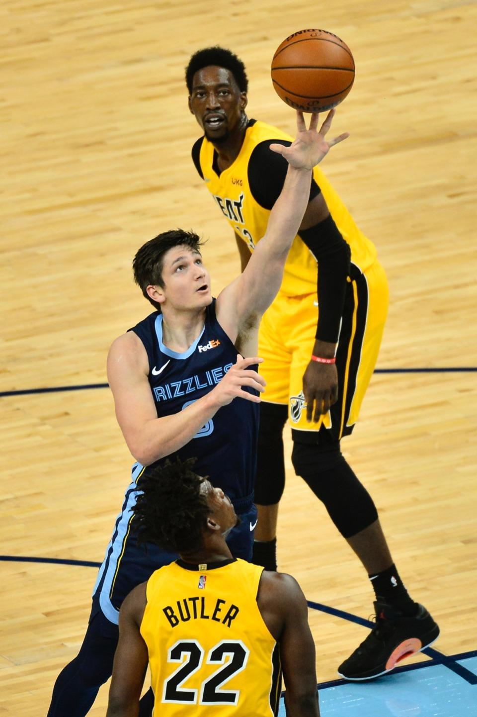 <strong>Memphis Grizzlies guard Grayson Allen shoots between Miami Heat forward Jimmy Butler (22) and center Bam Adebayo&nbsp;on March 17, 2021, at FedExForum.</strong> (Brandon Dill/AP)
