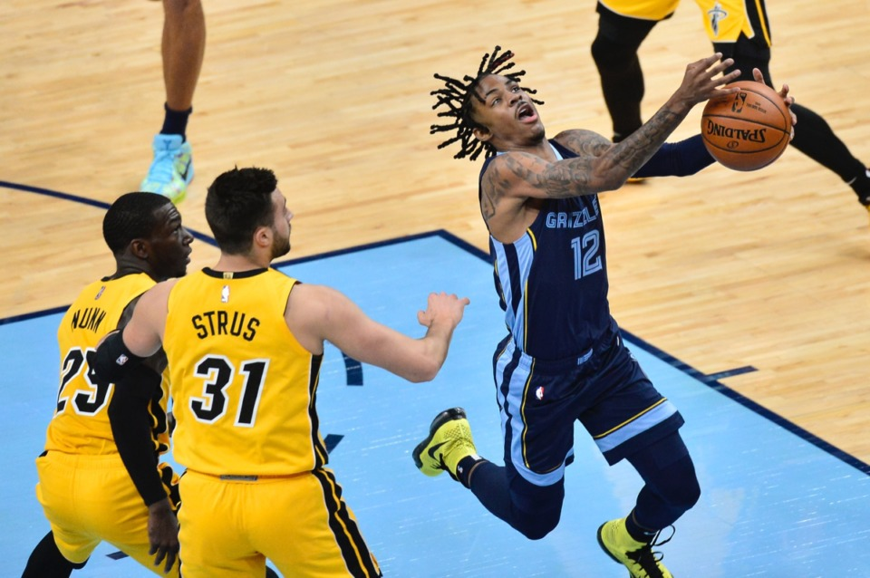 <strong>Grizzlies guard Ja Morant (12) struggles to control the ball ahead of Miami Heat guards Max Strus (31) and Kendrick Nunn (25) on March 17, 2021, at FedExForum.</strong> (Brandon Dill/AP)Photo/Brandon Dill)