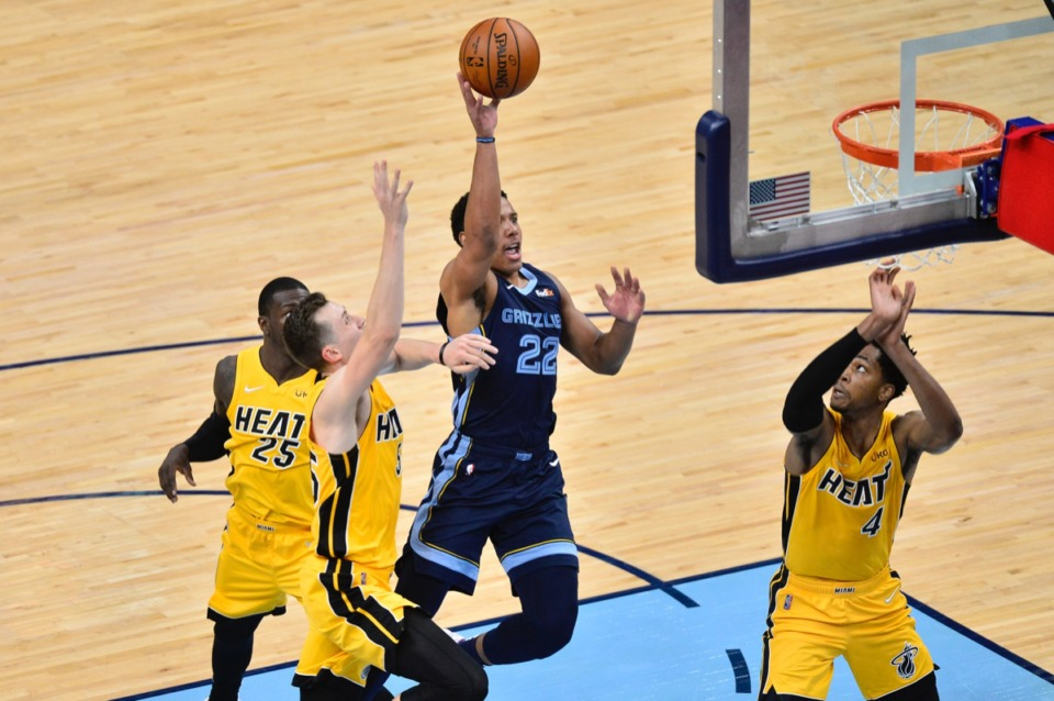 <strong>Grizzlies guard Desmond Bane (22) shoots against Miami Heat guard Duncan Robinson (55) and forward KZ Okpala (4) on March 17 at FedExForum.</strong> (Brandon Dill/AP)