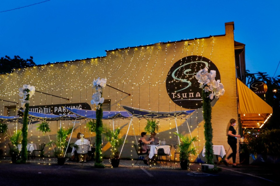 <strong>Tsunami patrons enjoy dinner on the Cooper-Young restaurant&rsquo;s outdoor seat in their parking on Thursday, July 23, 2020. The fine dining establishment is only providing outside service due to the pandemic.</strong> (Mark Weber/Daily Memphian file)
