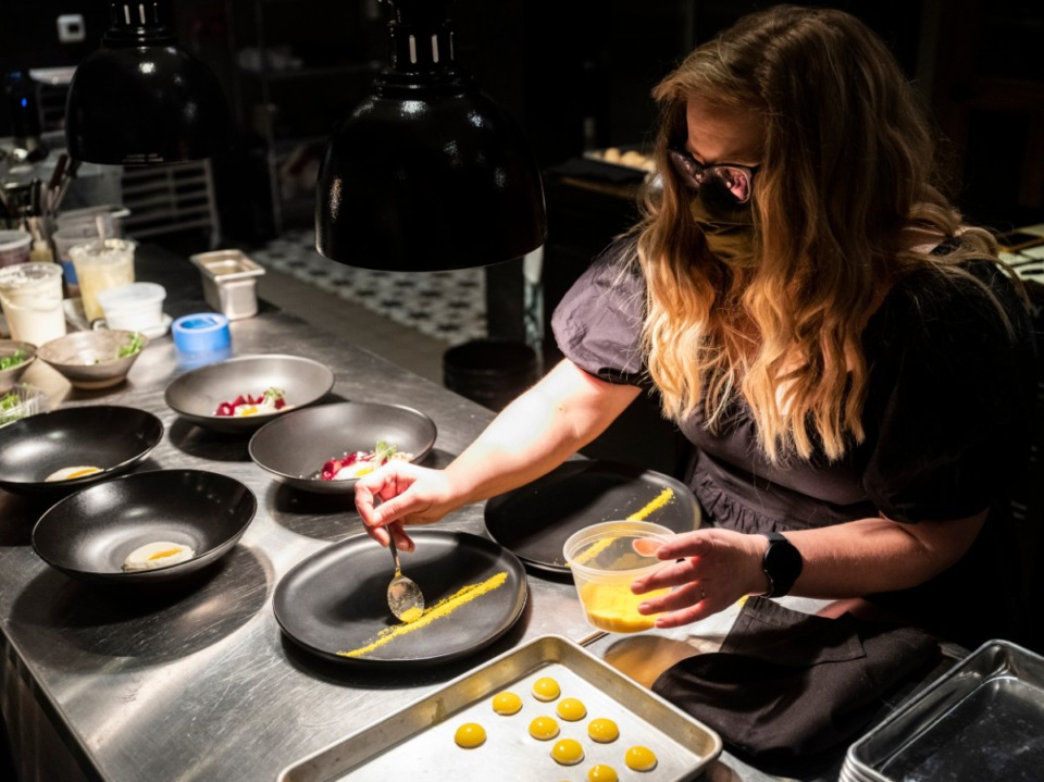 <strong>Amanda Krog helps in the kitchen at Dory on Jan. 22, 2021. Dory is a new restaurant in East Memphis owned by Amanda Krog and her husband, chef Dave Krog.</strong> (Brad Vest/Special to Daily Memphian file)