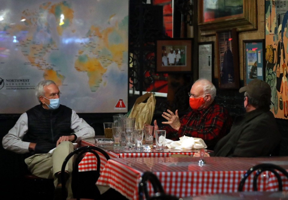 <strong>Rob Norcross (from right), Breen Bland and Barney Rolfes have a conversation during lunch at Rendezvous Dec. 1, 2020.</strong> (Patrick Lantrip/Daily Memphian file)