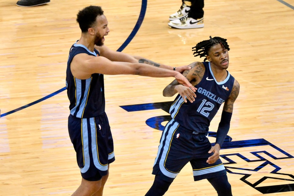 <strong>Memphis Grizzlies forward Kyle Anderson celebrates with guard Ja Morant (12) after Morant scored the game-winning shot against the Miami Heat on Wednesday, March 17, at FedExForum.</strong> (Brandon Dill/Associated Press)