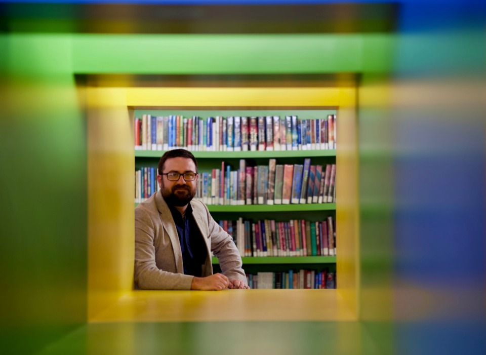 <strong>Architect Michel Lebel, at one end of the children&rsquo;s cube shelving Allen &amp; Hoshall designed for the library.</strong> (Tom Bailey/Daily Memphian)