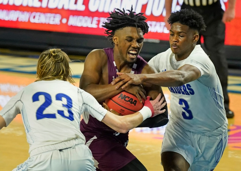 <strong>Collierville's Jordan Coleman (2) runs into traffic on the way to the basket in the Division I Class AAA quarterfinal game against Cleveland during TSSAA boys basketball state tournament at Middle Tennessee State University pm March 18, 2021, in Murfreesboro, Tennessee.</strong> (Larry McCormack/Special to The Daily Memphian)