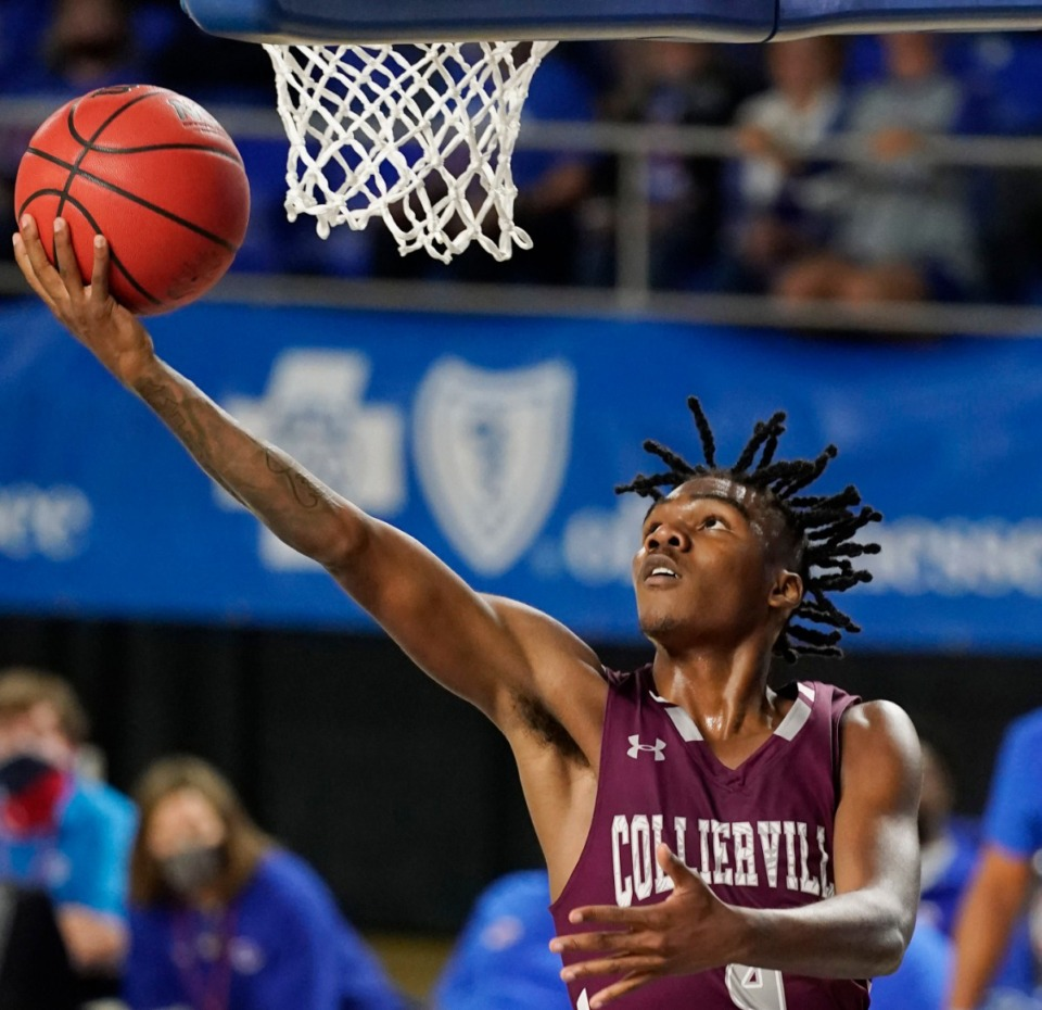 <strong>Collierville's Jordan Jenkins (4) goes up 9for a layup as Cleveland plays Collierville at the Division I Class AAA quarterfinal game on March 18, 2021, in Murfreesboro, Tennessee.</strong> (Larry McCormack/Special to The Daily Memphian)