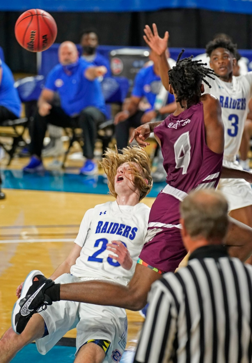 <strong>Cleveland's Kley McGowan (23) is knocked down by Collierville's Jordan Jenkins (4)</strong>&nbsp;<strong>at the Division I Class AAA quarterfinal game on March 18, 2021, in Murfreesboro, Tennessee.</strong> (Larry McCormack/Special to The Daily Memphian)