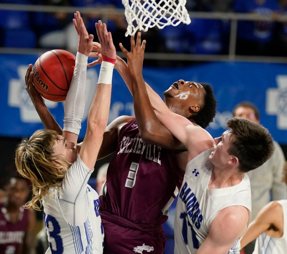 <strong>Collierville's Davon Barnes (3) is fouled by Cleveland's Grant Hurst (11) and Cleveland's Kley McGowan (23)</strong> <strong>at the Division I Class AAA quarterfinal game on March 18, 2021, in Murfreesboro, Tennessee.</strong> (Larry McCormack/Special to The Daily Memphian)