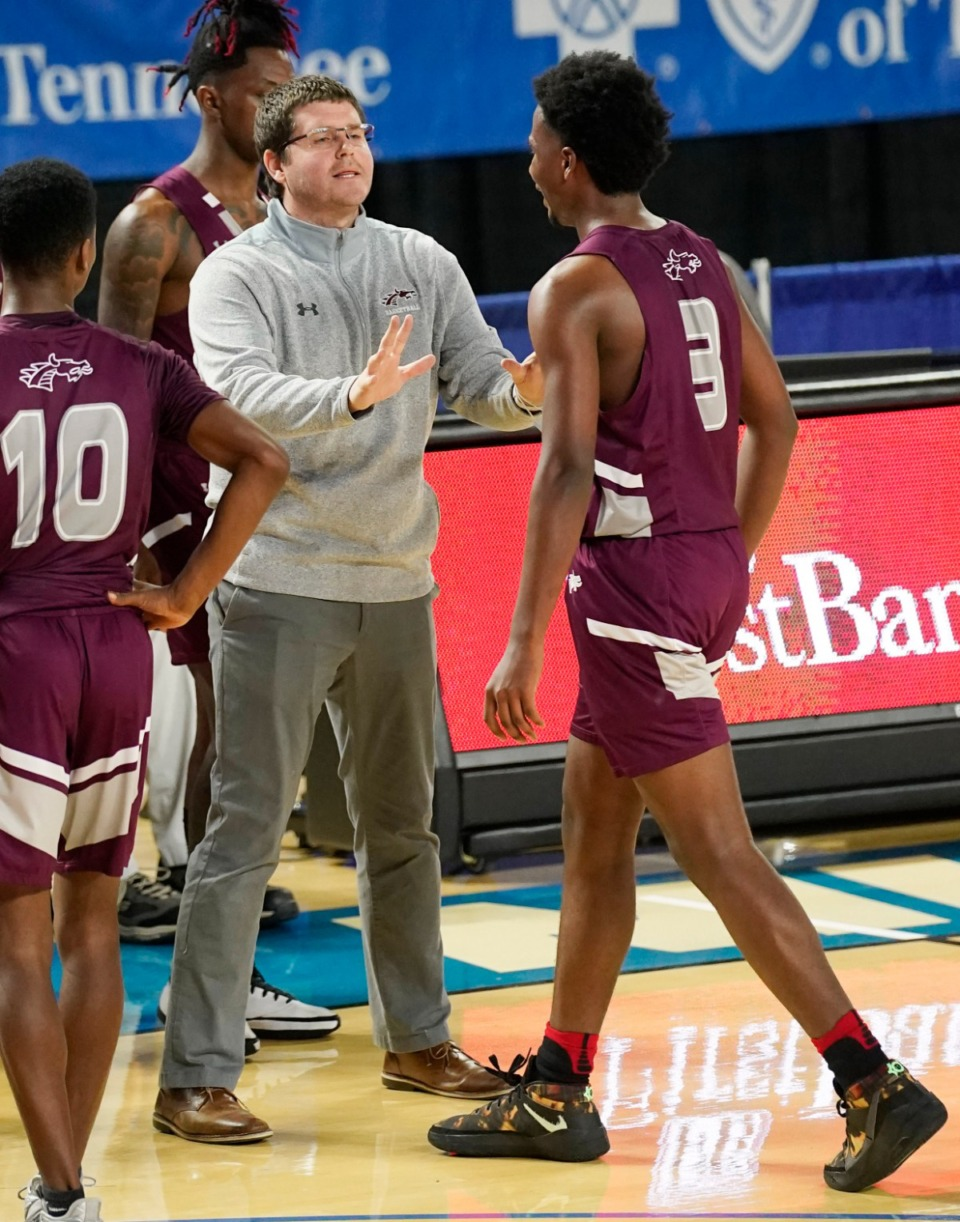 <strong>Collierville head coach Scott Robinson talks with Collierville's Davon Barnes (3) in the game against Cleveland</strong>&nbsp;<strong>at the Division I Class AAA quarterfinal game on March 18, 2021, in Murfreesboro, Tennessee.</strong> (Larry McCormack/Special to The Daily Memphian)
