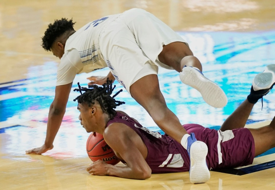 <strong>Cleveland's Jasen Brooks(3) and Collierville's Jordan Jenkins (4) scramble for a loose ball&nbsp;at the Division I Class AAA quarterfinal game on March 18, 2021, in Murfreesboro, Tennessee.</strong> (Larry McCormack/Special to The Daily Memphian)