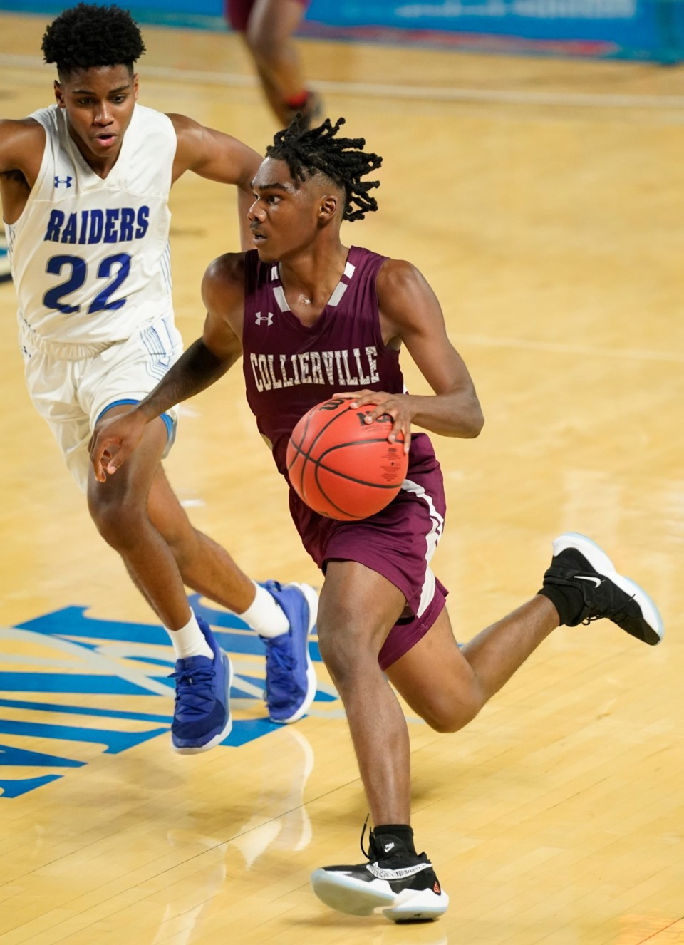 <strong>Collierville's Jordan Jenkins (4) moves the ball downcourt against Cleveland</strong>&nbsp;<strong>at the Division I Class AAA quarterfinal game on March 18, 2021, in Murfreesboro, Tennessee.</strong> (Larry McCormack/Special to The Daily Memphian)