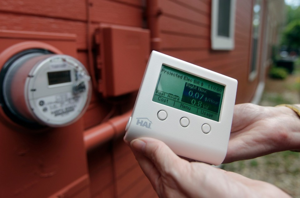 <strong>Memphis resident Denise Watts shows the home display for her MLGW Smart Meter that shows peak energy usage, projected electricity cost and daily usage. The information on the home display mirrors the information on her outside Smart Meter.</strong> (Daily Memphian file)