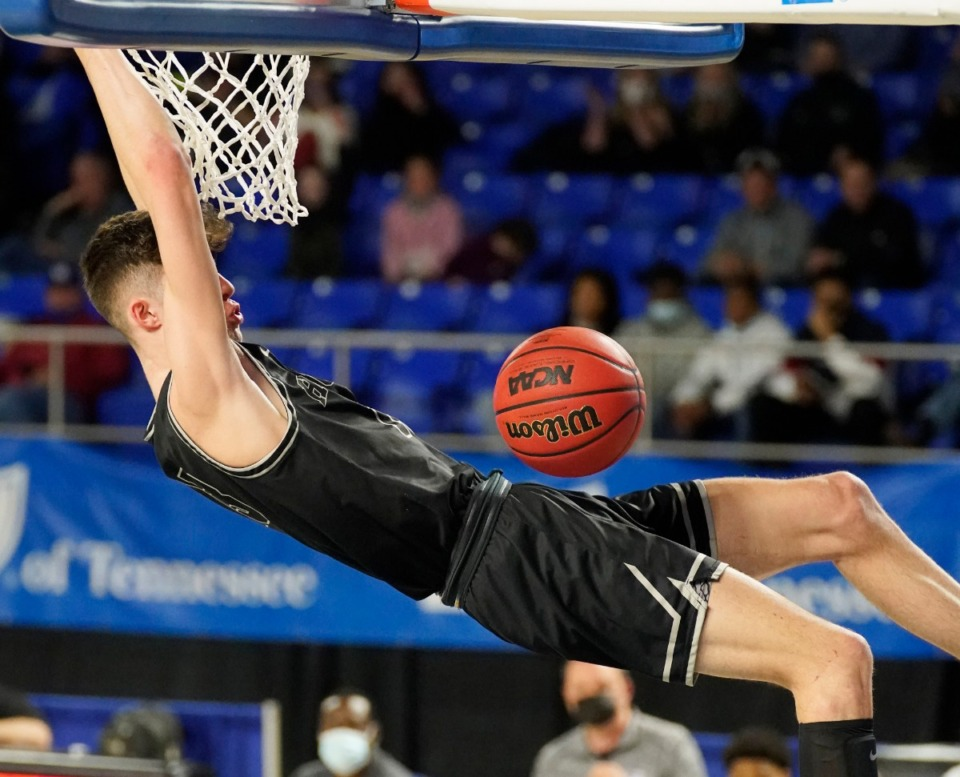 <strong>Houston&rsquo;s Mason Miller (13) dunks against Clarksville at the Division I Class AAA quarterfinal game during TSSAA boys basketball state tournament at Middle Tennessee State University on Thursday March 18, 2021, in Murfreesboro, Tennessee.</strong> (Larry McCormack/Special to The Daily Memphian)