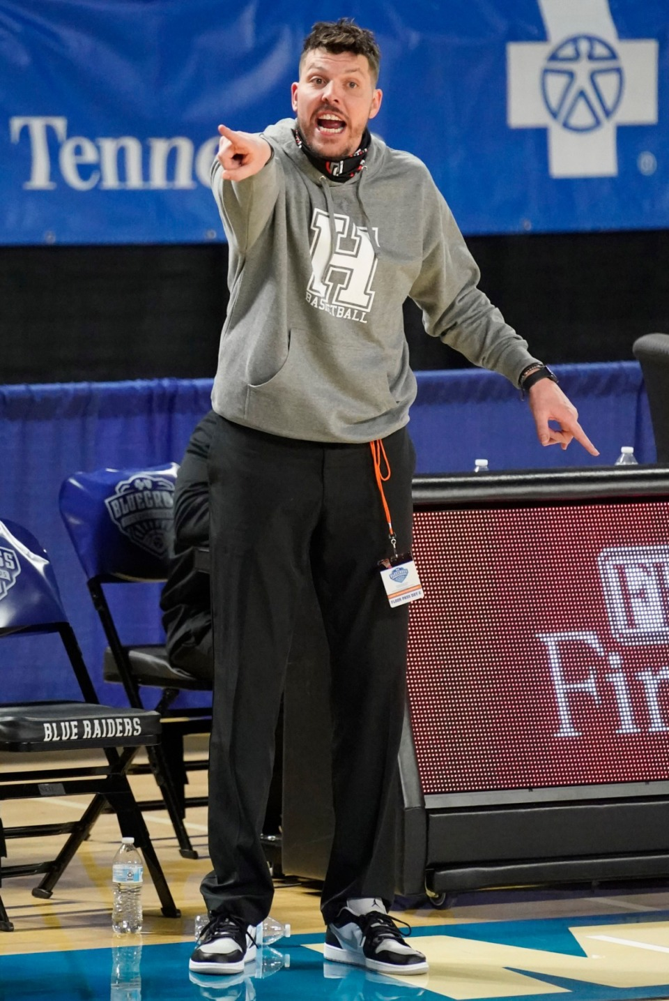 <strong>Houston head coach Michael Miller shouts instructions to his team as Houston plays Clarksville</strong>&nbsp;<strong>at the Division I Class AAA quarterfinal game on March 18 in Murfreesboro, Tennessee.</strong> (Larry McCormack/Special to The Daily Memphian)