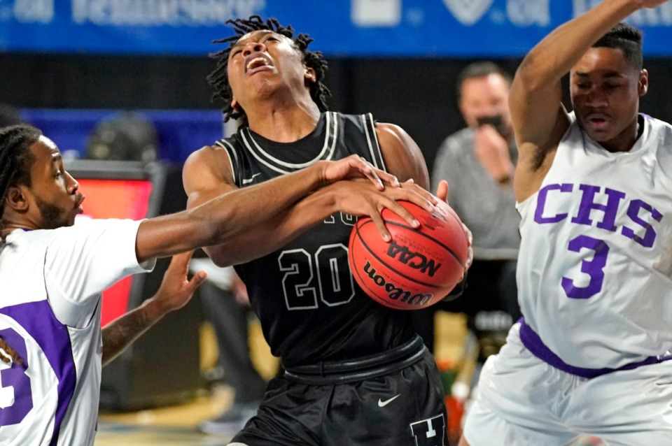 <strong>Houston&rsquo;s Jaiden McCranie (2) is fouled as he goes to the basket against Clarksville&nbsp;at the Division I Class AAA quarterfinal game on March 18 in Murfreesboro, Tennessee.</strong> (Larry McCormack/Special to The Daily Memphian)